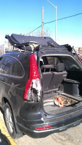 A car's trunk door ripped above it's roof due to the force of Superstorm Sandy in Staten Island, NY.