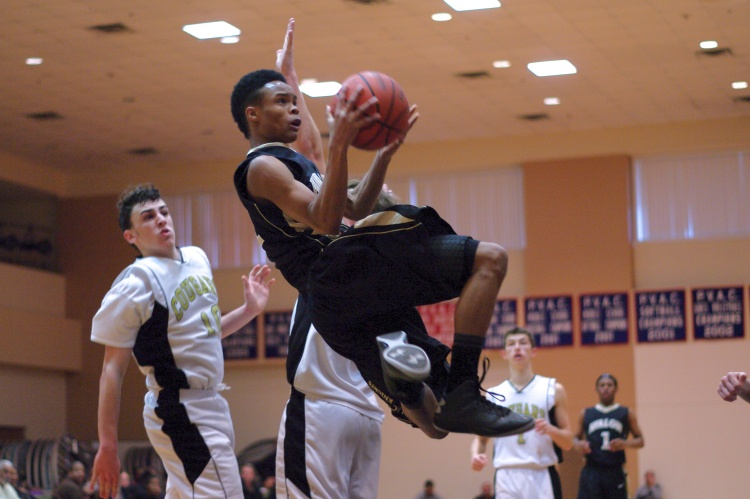Zamir Courtney flies through the air on a layup attempt in a game against Covenant Life School on January 26, 2013.