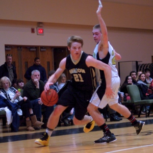 Senior Emmett Sloan drives past a Covenant Life defender in a game on January 26, 2013 in Laytonsville, Md.