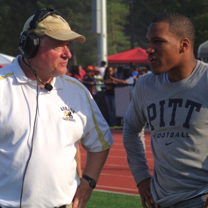 Former Avalon running back Rachid Ibrahim, right, meets with Avalon coach Tad Shields at halftime on Oct. 5, 2013, during a game against Riverdale Baptist in Upper Marlboro, Md.