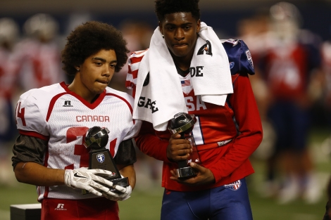 Team Canada running back Jevante Stanley and Team USA wide receiver Trevon Diggs receive their MVP trophies after the International Bowl at At&T Stadium in Dallas, Texas, on January 30, 2015.