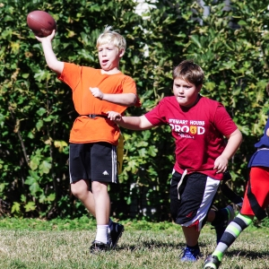 Stewart House quarterback Greg Kolf throws as pass as lineman Drew Kelly blocks, in a flag football game against Calvert House, on October 25, 2016, in Gaithersburg, Maryland.