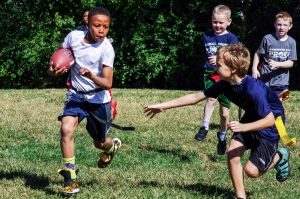 Washington House receiver Trey Simmons, left, runs the ball around Carroll Houses Anton Parker in a flag football game on October 25, 2016, in Gaithersburg, Maryland.