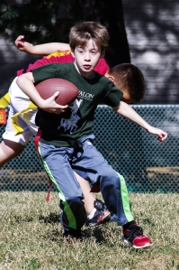 Calvert House receiver Francesco Contini maneuvers around defenders in a flag football game against Stewart House on October 25, 2016, in Gaithersburg, Maryland.